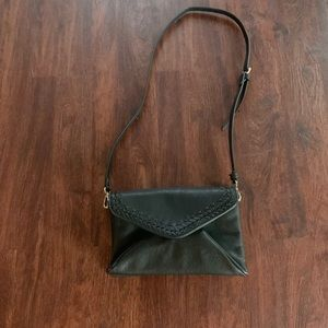 Beautiful black leather bag by anthropologie